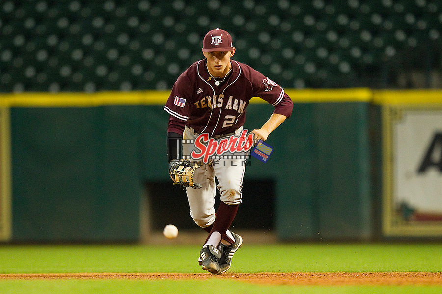First baseman Jacob House #27 of the Texas A&M Aggies charges a ground ball against the Rice Owls at Minute Maid Park on March 5, 2011 in Houston, Texas.  Photo by Brian Westerholt / Four Seam Images