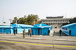Republic of Korea (South Korea) soldiers stand guard at the Joint Security Area in between North Korea and South Korea in the village of Panmunjom on March 15, 2013.   Tensions have been steadily rising since North Korea detonated a nuclear device in February.  The United States has repositioned several military assets in support of South Korea.