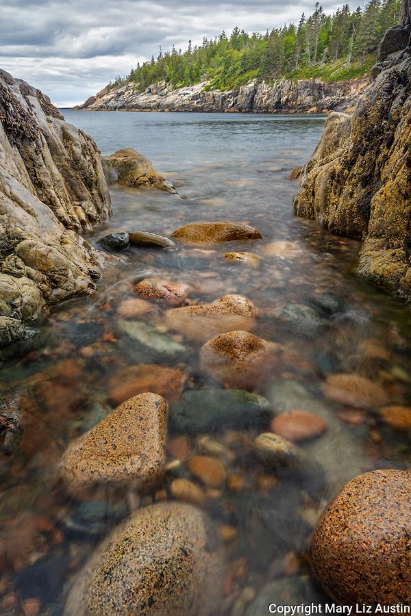 Acadia National Park, Maine: Rounded boulders and rocks in surf at Hunters Beach