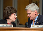 United States Senators Susan Collins (Republican of Maine), left, and Bill Cassidy (Republican of Louisiana) right, have a discussion during the confirmation hearing for R. Alexander Acosta, Dean of Florida International University College of Law and US President Donald J. Trump's nominee for US Secretary of Labor  before the US Senate Committee on Health, Education, Labor & Pensions on Capitol Hill in Washington, DC on Wednesday, March 22, 2017.<br /> Credit: Ron Sachs / CNP