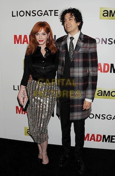 HOLLYWOOD, CA- APRIL 02: Actress Christina Hendricks (L) and husband Geoffrey Arend arrive at AMC's 'Mad Men' Season 7 premiere at ArcLight Cinemas on April 2, 2014 in Hollywood, California.<br /> CAP/ROT/TM<br /> &copy;Tony Michaels/Roth Stock/Capital Pictures