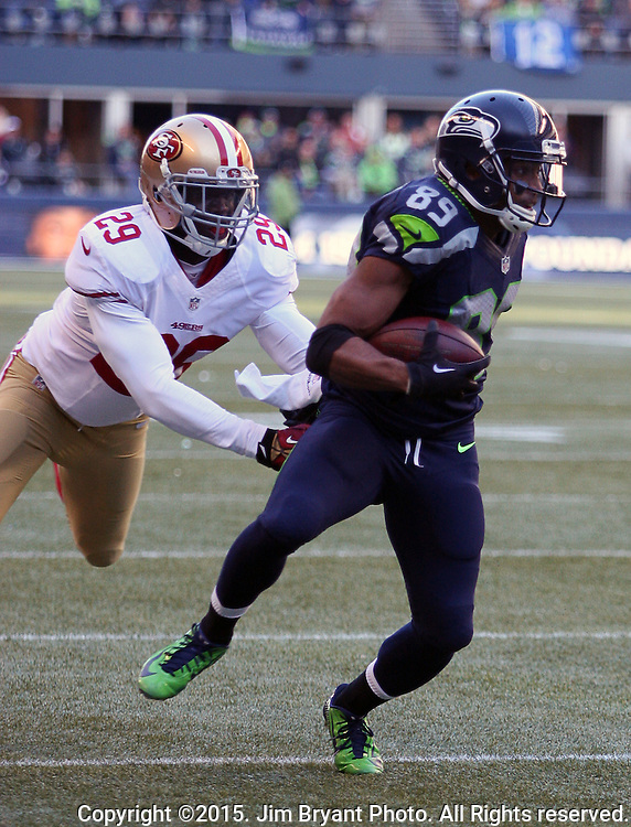 Seattle Seahawks wide receiver Doug Baldwin (89) tries to get away San Francisco 49ers defensive back Jaquiski Tartt (29) at CenturyLink Field in Seattle, Washington on November 22, 2015.  The Seahawks beat the 49ers 29-13.   ©2015. Jim Bryant Photo. All RIghts Reserved.