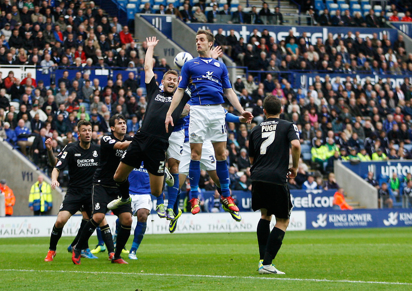 Leicester City's Andy King (C) jumps for a header<br /> <br /> Photo by Jack Phillips/CameraSport<br /> <br /> Football - The Football League Sky Bet Championship - Leicester City v Bournemouth - Saturday 26th October 2013 - King Power Stadium - Leicester<br /> <br /> &copy; CameraSport - 43 Linden Ave. Countesthorpe. Leicester. England. LE8 5PG - Tel: +44 (0) 116 277 4147 - admin@camerasport.com - www.camerasport.com