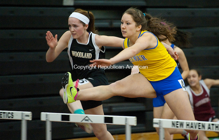 NEW HAVEN, CT-012014JS06-Seymour's Diana Janus and Woodland's Audra Blewitt  battle in the 55-meter hurdles during the NVL indoor boys and girls track championships Tuesday at the Floyd Little Athletic Center at Hillhouse High School in New Haven.<br /> Jim Shannon Republican-American