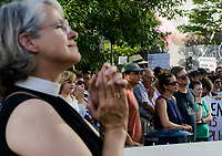 NWA Democrat-Gazette/CHARLIE KAIJO Attendees listen to speakers during a rally, Saturday, June 30, 2018 at the downtown square in Fayetteville. <br /> <br /> The rally in Fayetteville is one of hundreds of rallies planned as part of a Families Belong Together national day of action to protest the administration&rsquo;s &ldquo;zero tolerance&rdquo; immigration policy, which remains in effect. Advocacy groups such as MoveOn, the Human Rights Campaign and the American Civil Liberties Union have joined in, and at least 130 rallies in 48 states are planned.