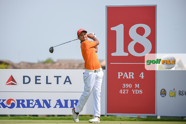 Leon Philip D'SOUZA (HKG) watches his tee shot on 18 during Rd 1 of the Asia-Pacific Amateur Championship, Sentosa Golf Club, Singapore. 10/4/2018.<br /> Picture: Golffile | Ken Murray<br /> <br /> <br /> All photo usage must carry mandatory copyright credit (© Golffile | Ken Murray)