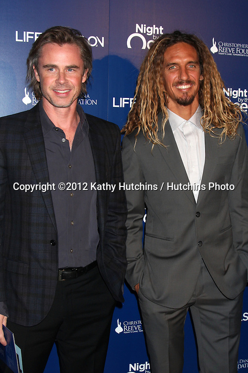 LOS ANGELES - NOV 11:  Sam Trammell, Rob Machado arrives at the Life Rolls On Foundation's 9th Annual Night By The Ocean at The Ritz-Carlton on November 11, 2012 in Marina del Rey, CA