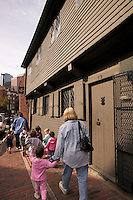 Paul Revere House Boston MA; small children on school class field trip walk on the red brick Freedom Trail in North Boston