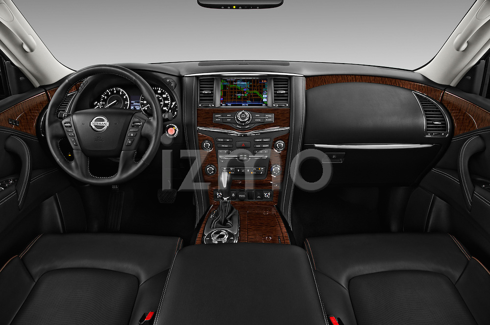Stock photo of straight dashboard view of 2018 Nissan Armada Platinum 5 Door SUV Dashboard