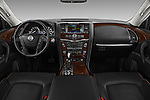 Stock photo of straight dashboard view of 2017 Nissan Armada Platinum 5 Door SUV Dashboard