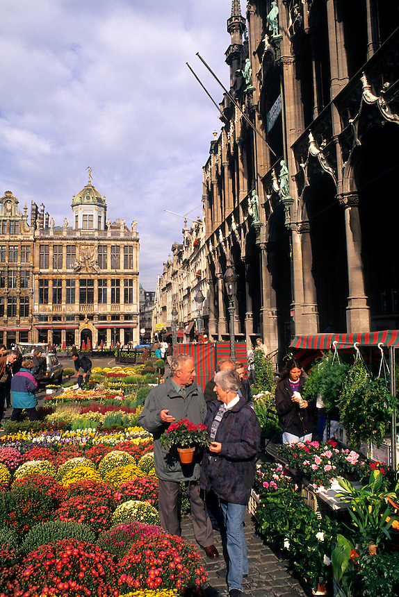 People in famous landmark Grand Place in Brussels Belgium with flower market