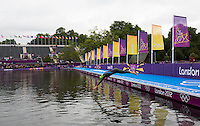 04 AUG 2012 - LONDON, GBR - Aileen Morrison (IRL) of Ireland  dives into The Serpentine for a warm up swim before the start of the women's London 2012 Olympic Games Triathlon in Hyde Park in London, Great Britain (PHOTO (C) 2012 NIGEL FARROW)
