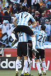 17 JUN 2010: Jonas Gutierrez (ARG) (17) jumps on the back of Martin Demichelis (ARG) (2) as they celebrate a goal. The Argentina National Team defeated the South Korea National Team 4-1 at Soccer City Stadium in Johannesburg, South Africa in a 2010 FIFA World Cup Group E match.