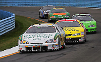 Aug. 8, 2009; Watkins Glen, NY, USA; NASCAR Nationwide Series driver Kenny Wallace (28) leads Michael Annett (15) during the Zippo 200 at Watkins Glen International. Mandatory Credit: Mark J. Rebilas-