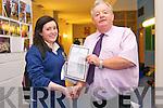 Pobal Scoil Chorca Dhuibhne principal Paidrag Firtéar presenting Eimear Ní Dhubhain  her Junior Certificate results on Wednesday.