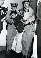 "SIT-IN AT SPROUL HALL, University of California at Berkeley. One of the students is carried out by U.C Police. Students were protesting the ""Free Speech"" issue at the University (1964 photo by Ron Riesterer)."