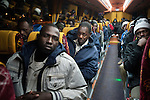 African asylum-seekers board a bus on their way to Jerusalem, after walking on a protest march along a road north of Be'er Sheva, Israel. Some 200 African asylum-seekers, who illegally entered Israel, demonstrated against their condition at a detention facility, from which they walked out of two days earlier. At the end of the walk in Jerusalem, Israeli police and immigration arrested all protestors, and sent them back to Saharonim detention facility in the Negev desert.