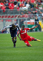22 May 2010: New England Revolution defender Corey Gibbs #12 and Toronto FC forward O'Brian White #17 in action during a game between the New England Revolution and Toronto FC at BMO Field in Toronto..Toronto FC won 1-0.....