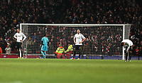 Wednesday 16 January 2013<br /> Pictured L-R: Swansea players Kyle Bartley, Michel Vorm, Chico Flores and Pablo Hernandez stand dejected after Jack Wilshere's late goal.<br /> Re: FA Cup third round replay, Arsenal v Swansea City FC at the Emirates Stadium, London.