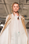 Collection by Ellen Wilson from the University of Salford. Graduate Fashion Week 2014, Runway Show at the Old Truman Brewery in London, United Kingdom. Photo credit: Bettina Strenske