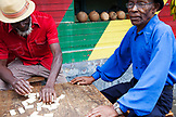 "JAMAICA, Port Antonio. Joseph ""Powder"" Bennett and Derrick ""Johnny"" Henry of the Mento band, The Jolly Boys playing dominoes at the Willow Wind Bar."