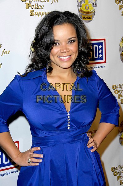 KIMBERLY LOCKE.Arrivals to A Tribute to the USO, a musical and video tribute to seven decades of USO service at the Saban Theatre. Beverly Hills, CA, USA. .February 21, 2010.half length blue dress hands on hips .CAP/CEL/RL.©CelPh/Capital Pictures/Rich Linton