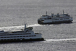 Washington State Ferries  pass one another while arriving and departing from Seattle's Coleman Dock.  Jim Bryant Photo. ©2010. All Rights Reserved.