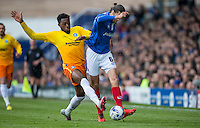 Gozie Ugwu of Wycombe Wanderers  battles with Christian Burgess of Portsmouth during the Sky Bet League 2 match between Portsmouth and Wycombe Wanderers at Fratton Park, Portsmouth, England on 23 April 2016. Photo by Andy Rowland.