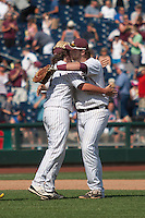 Mississippi State first baseman Wes Rea (35) hugs closer  Jonathan Holder (14) at the conclusion of Game 11at the 2013 Men's College World Series against the Oregon State Beavers on June 21, 2013 at TD Ameritrade Park in Omaha, Nebraska. The Bulldogs defeated the Beavers 4-1, to reach the CWS Final and eliminating Oregon State from the tournament. (Andrew Woolley/Four Seam Images)