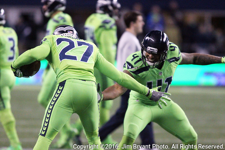 Seattle Seahawks defensive back Neiko Thorpe (27) celebrates with linebacker Dewey McDonald (41)after recovering a loose ball after punter Jon Ryan (9) fumbled after getting hit by Los Angeles Rams defensive back Michael Jordan (35) after running for 26 yards on a fake punt against the at CenturyLink Field in Seattle, Washington on December 15, 2016.  Ryan was shaken up and taken helped from the field. The Seahawks beat the Rams 24-3.  ©2016. Jim Bryant Photo. All Rights Reserved