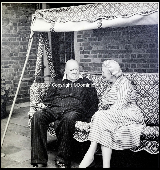 BNPS.co.uk (01202 558833)<br /> Pic:  DominicWinter/BNPS<br /> <br /> Winston Churchill with his wife Clementine.<br /> <br /> Charming photos of Winston Churchill with his grandchildren have emerged for sale - alongside one of his trademark cigars.<br /> <br /> The candid snaps reveal Churchill enjoying the company of his wife Clementine and their grandchildren at Chartwell, their family home.<br /> <br /> They were taken in 1951, at which point he had just been re-installed as Prime Minister after a six year absence.<br /> <br /> The partly-smoked cigar was taken by a naval officer as a memento of the British wartime leader's stay on board HMS Pembroke in 1943.