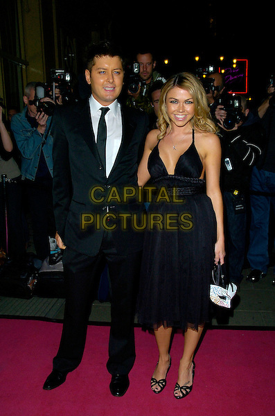 BRIAN DOWLING & ADELE SILVA.Attends The Pink Ice Ball, The Waldorf Hilton Hotel, London, England, October 5th 2007..full length black dress.CAP/CAN.©Can Nguyen/Capital Pictures