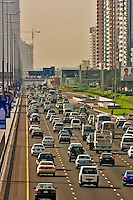 Dubai. United Arab Emirates.  Heavy traffic on the Sheikh Zayed Road/Abu Dhabi Road..