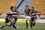 Siale Piutau has the support of Sione Sione & Niva Ta'auso during the Air NZ Cup game between the Counties Manukau Steelers and Southland played at Mt Smart Stadium on 3rd September 2006. Counties Manukau won 29 - 8.