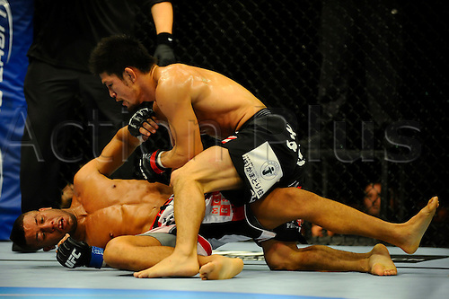 5.11.2011 Birmingham, England. Michihiro Omigawa (JAP) (black shorts) fights Jason Young (ENG) (red shorts) in a Featherweight bout on the Undercard during UFC 138: Leben vs. Munoz at the LG Arena. Omigawa defeated Young via unanimous decision (29-28, 29-28, 29-28).