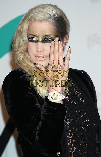 Ke$ha, Kesha, Kesha Rose Sebert.Ke$ha unveils her new 'Baby G' watch line design at SLS Hotel, Beverly Hills, California, USA..October 29th, 2012.half length black top lace jacket gold make-up eyes white watch wristwatch bracelet nail varnish polish hand.CAP/ADM/RE.©Russ Elliot/AdMedia/Capital Pictures.