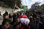 Mourners carry the body of Palestinian Amal el-Tramsi, 43, who was shot dead by c during clashes on Israel-Gaza border, during her funeral in Gaza city, on January 12, 2019. Photo by Ashraf Amra
