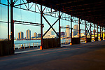 The skyline of New Orleans is visible thru the steel frame of an old factory buildng located in the newly developed Crescent Park on the banks of the Mississippi River in New Orleans.