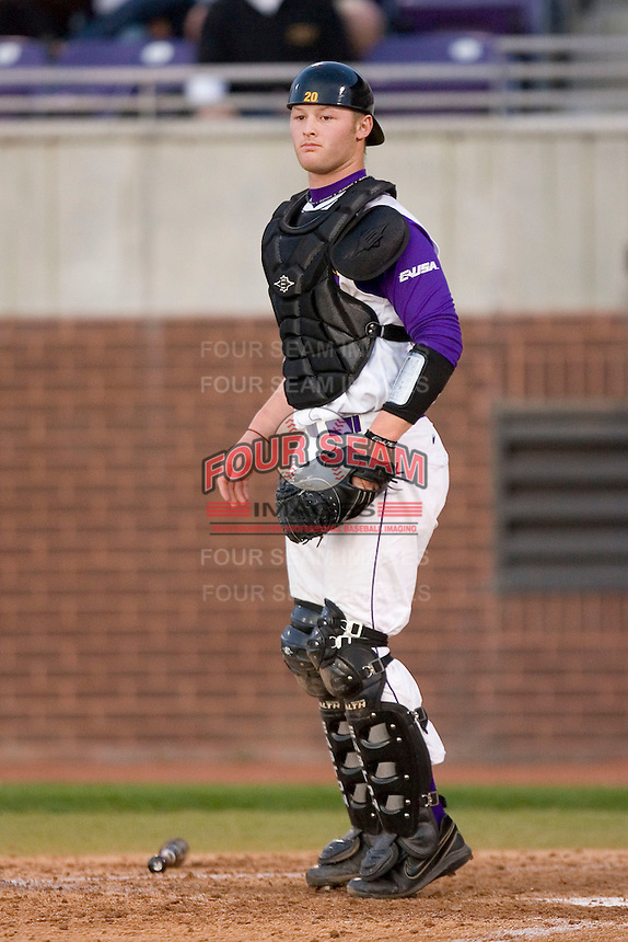 Catcher Zach Wright #20 of the East Carolina Pirates on defense versus the Elon Phoenix at Clark-LeClair Stadium March 29, 2009 in Greenville, North Carolina. (Photo by Brian Westerholt / Four Seam Images)