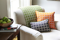 Matching soft furnishing designs in variations of purple, orange and green