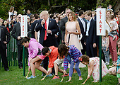 United States President Donald Trump blows a whistle to start an egg roll as First Lady Melania Trump and son Barron look on during the annual Easter Egg Roll on the South Lawn of the White House  in Washington, DC, on April 17, 2017. <br /> Credit: Olivier Douliery / Pool via CNP