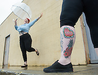 Brie Felts celebrates finishing her latest tattoo on Valerie Gunther's leg at Primal Instinct Tattoo. Photo by James R. Evans