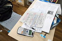 Home work left on a desk during a meal break at the prestigious Shanghai High School in Shanghai, China on 27 February, 2014.  As one of the most demanding and exclusive high school in the country, Shanghai High School puts grueling study hours on its students, academic studies often last from 6:45 Am to as late as 9 PM.
