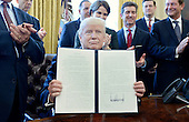 United States President Donald Trump, flanked by business leaders, signs executive order establishing regulatory reform officers and task forces in US agencies in the Oval Office of the White House on February 24, 2017 in Washington, DC. <br /> Credit: Olivier Douliery / Pool via CNP