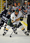 1 February 2008: University of Vermont Catamounts' forward Wahsontiio Stacey, a Freshman from Kahnawake, Quebec, maintains possession of the puck against University of New Hampshire Wildcats' forward Greg Collins, a Junior from Fairport, NY, at Gutterson Fieldhouse in Burlington, Vermont. The seventh-ranked Wildcats defeated the Catamounts 5-1in front of a sellout crowd of 4,003...Mandatory Photo Credit: Ed Wolfstein Photo