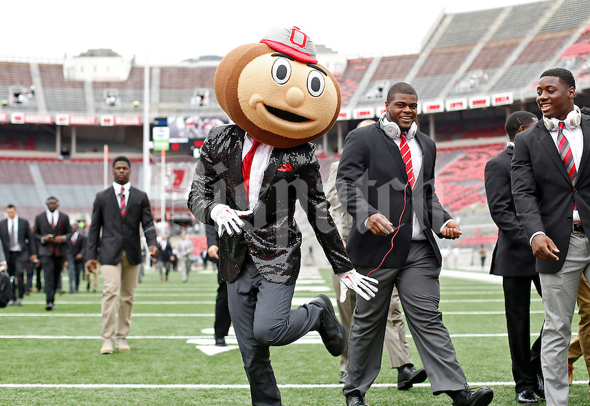 Brutus Buckeye and the Ohio State Buckeyes football team make their way into Ohio Stadium for their game against Western Michigan on September 26, 2015.  (Dispatch photo by Kyle Robertson)