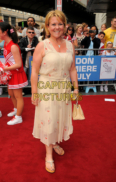 "WENDI PETERS.Attending the ""High School Musical"" stage show Press Night at the Hammersmith Apollo Theatre, London, England, UK, July 5th 2008..outside arrivals full length cream dress bel bag.CAP/CAN.©Can Nguyen/Capital Pictures"