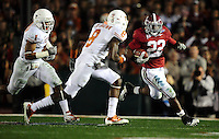 Jan 7, 2010; Pasadena, CA, USA; Alabama Crimson running back Mark Ingram (22) runs with the ball while being defended by the Texas Longhorns during the second quarter of the 2010 BCS national championship game at the Rose Bowl.  Mandatory Credit: Mark J. Rebilas-