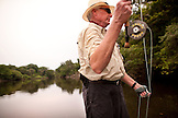 BRAZIL, Agua Boa, man fly fishing on a tributary of the Amazon River, Agua Boa River and resort