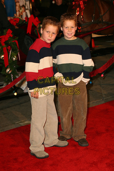 "BRENT KINSMAN & SHANE KINSMAN.""Cheaper By The Dozen 2"" World Premiere - Arrivals .held at the Mann Village Theatre, Westwood, California..December 13th, 2005.Photo: Zach Lipp/AdMedia/Capital Pictures.Ref: ZL/ADM.half length brothers twins brown trousers striped stripes jumper swaeter.www.capitalpictures.com.sales@capitalpictures.com.© Capital Pictures."